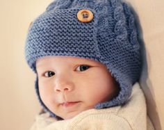 Knitting pattern for a baby aviator hat with single button chin fastening.  The pattern gives instructions for four sizes of baby hat: 0-3 months, 3-6 months, 6-12 months and 1 - 2 years.  It is knit flat on two needles.  My patterns are written in standard american and UK terms with clear instructions and plenty of pictures to guide you.  **IMMEDIATE DOWNLOAD** No waiting! You will be able to download the file as soon as your payment has been confirmed  YARN: Any double knit/ light worsted…