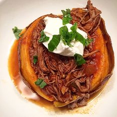 Slow Cooker Ropa Vieja Stuffed Baked Sweet Potato. So good! I used ground/dried spices instead (cumin & oregano) and crusted it on the beef during browning rather than than straight into the crockpot. Also added jalapeño and capers and omitted the tomato sauce. So yummy!