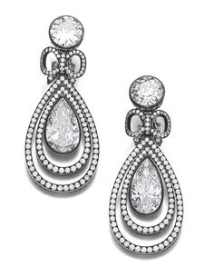 Each collet-set with a circular-cut diamond, suspending a pear-shaped diamond, accented with a small bow motif, highlighted with brilliant-cut stones, each with maker's mark.