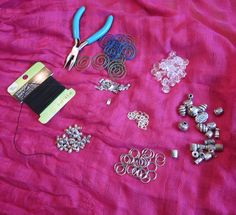 1. The ingredients: Elastic cording, pliers, round paperclips, crimpable end-cap, clear beads, silver beads. small jump-rings, small rings, charms (I used crosses)