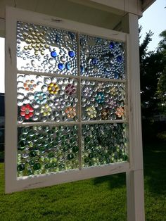 My version of a stained glass window using a vintage window, flat gems and epoxy. The epoxy is poured over all the gems. Took a quart to do an approximately 2 x 3' window. A quart costs a bit over $25 so this is one of my more expensive craft projects.