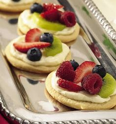 "sugar cookie fruit mini ""pizza""... if you want a tart shape cookie, turn a muffin tin upside down and mold cookie dough on outside of the muffin cups and bake"