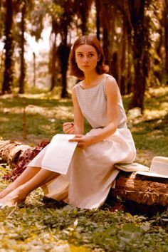 Audrey Hepburn - Writing a letter in a palm grove in 1955.