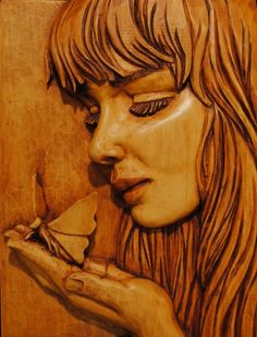 Girl with Butterfly - Basswood, 10x14x2. Design by Fred Zavadil.