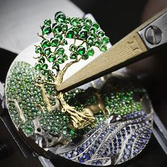 Watches&Wonders 2015 - The Poetry of Time™ by Van Cleef & Arpels. Positioning an emerald set motif of the Lady Arpels Peau d'Âne Forêt enchantée watch.