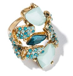 "Avon: mark Wild Blue Ring.  Proof that being all over the place can be a very good thing: this fun ring, with its mash-up of scattered stones in cool blue and green tones, is a little wild and totally gorgeous! Glass stones in a goldtone setting. 1 1/2"" H.  Get it now at www.KonaBeauty.com."