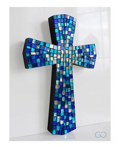 Mosaic Cross shaded blue glass mirror Multicolor This mosaic cross is made with a mix of multi-colored glass in shades of blue and silver in order to create special vibes of Light. Customization: by changing the choice of the glass color mix you can create endless effects and vibes.