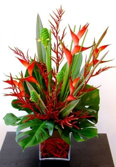 Beautiful Bird of Paradise flower arrangement - Reminds me of the Caribbean. Tropical Flowers, Tropical Flower Arrangements, Church Flower Arrangements, Beautiful Flower Arrangements, Exotic Flowers, Flower Centerpieces, Flower Decorations, Beautiful Flowers, Cactus Flower