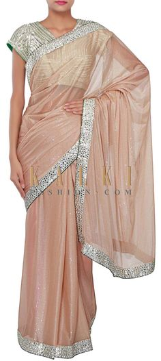 Buy Online from the link below. We ship worldwide (Free Shipping over US$100) http://www.kalkifashion.com/gold-foil-saree-adorn-in-mirror-and-zari-embroidered-border-only-on-kalki.html