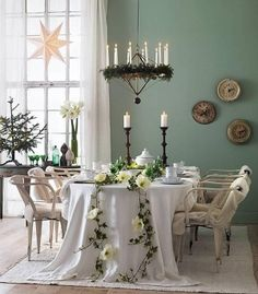 Mint green walls and floral garland table runner, love the tablecloth length