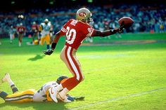 Jerry Rice (80) makes a one-handed catch in game action against the Los Angeles Rams