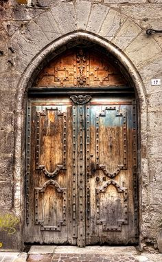 Cahors ~ Lot ~ France. Old wooden door, rustic, details, architechture, curve, beauty, photo