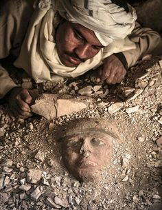 "''Face to face"": Unearthing a funerary mask in Luxor, Egypt - photo by Carlos Spottorno."
