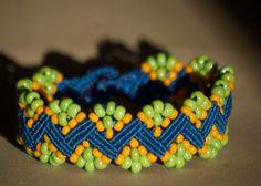 Fun, modified wave, blue,  green and orange macrame bracelet. $28,50, via Etsy.