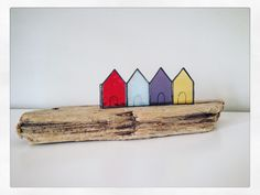 Drift Away Art is a mixture of Canadian driftwood and stained glass captured in the form of mini beach huts set upon a unique piece of beautiful driftwood.