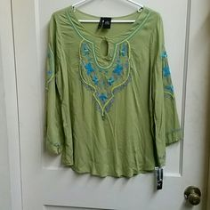 New Direction Green Top New Direction grean top with blue and yellow embroidery on the sleeves and on the front three quarter length sleeves that are cut at an angle as shown in the last picture does need to be ironed it was my my closet in the belk bag from where it was purchased. new directions Tops Blouses