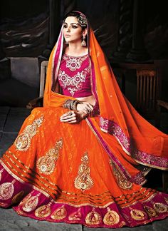 Orange and Pink Net and Velvet Lehenga Choli www.ethnicoutfits.com Email : support@ethnicoutfits.com What's app : +918141377746 Call : +918140714515