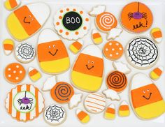 A terrific assortment of Halloween cookies that veer much more on October 31st's cute side :) #candy #corn #cookies #decorated #food #baking #dessert #cute #Halloween