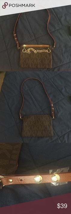 Micheal Kors Monogrammed Belt with wallet Like new, 3rd stud missing as shown in pic 3 but barely noticeable when worn,  wallet is 7.5 by 5 inches, belt circumference is 35 inches, sits on hips. Belt length adjustable using studs. Michael Kors Accessories Belts