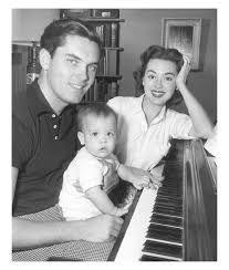 Jeffrey Hunter with wife Barbara Rush & baby
