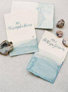 Watercolor escort cards: http://www.stylemepretty.com/2015/08/19/elegant-blue-nashville-wedding-2/   Photography: Jessica Lorren - http://www.jessicalorren.com/