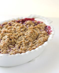 Raspberry Crisp - Grab a bowl and scoop some raspberry crisp in it and top it with some ice cream! The crisp topping is loaded with brown sugar and oats. This is the perfect end of summer dessert!