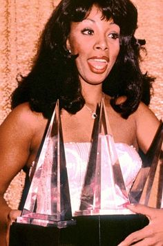 8. 1979: Donna Summer clutches the trophies she won at the American Music Awards