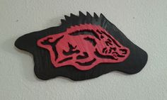 2 demoniacal wood Razorback plaque $25. plus $10 S/h .$ 10 or you pick it up in Clarksville .The football plaque is 18 ins long & 10 ins tall. Both pieces are painted with exterior paint. It would look great in a man cave. We do accept PayPal or money orders no checks. Message me for info as how to order 1. We do sell other hog crafts just scan down to find them.