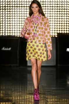 House of Holland Spring 2015--Henry Holland took a trip back to the 1970s with House of Holland's spring-summer 2015 runway show. Vibrant colors, kitschy f