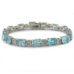Blue Topaz and Diamond Tennis Bracelet in Sterling Silver 7 inches 20ct tw. SuperJeweler. Save 35 Off!. $149.99. Total Gem Weight : TGW.. Diamond Weight ;. Gemstone :. Diamond Color / Clarity :. Mounting : Sterling-Silver