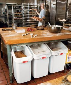 www.StailnlessSteelTile.com likes the flour bins under bench for a commercial kitchen