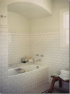 "White subway tile on the walls with *po$$ibly* white carrara marble hexagon tile for the floor?  Yes please.  This page has tons of images.  ""When searching for images of subway tile, I came across this one – the simplicity of the tile, combined with the vintage character of the floor, really reminds me of the NYC subway!"""