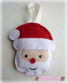 Felt Santa Handmade Ornament by rosecottagedesignss on EtsySanta will look lovely and cheery hanging on your Christmas tree. I have personally designed, cut by hand and sewn each Santa. Felt Christmas Decorations, Felt Christmas Ornaments, Christmas Crafts, Christmas Christmas, Glitter Ornaments, Beaded Ornaments, Christmas Centerpieces, Country Christmas, Glass Ornaments