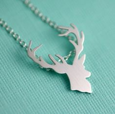"Fun, Rustic and Darling. This intricate Deer Head SIlhouette Necklace is the perfect amount of woodland whimsy and sophistication.A detailed Deer Head silhouette is hand pierced/sawed/filed sterling silver and then given a bright satin finish. The pendant measures just about 3/4"" from top to bottom and hangs from a sparkling sterling silver chain, secured with a sterling silver lobster clasp. Choose from 16"" or 18"" chain length."