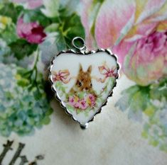 Bunny in the Roses Pendant Vintage Broken Shabby China was recycled to make this pretty Heart pendant charm. A Sweet little bunny resting in the roses. Slip it on your favorite chain as a pendant for a necklace. The china has been encased in a cu Valentine Treats, Valentines, Easter 2018, Broken China Jewelry, Vintage China, Jewelery, Bunny, Charmed, Pendant