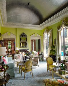 Long a purveyor of the English country style, what distinguishes Mr. Buatta is his keen sense of color and proportion. In the Rosses' living room, the windows wear couture curtains of silk taffeta hung from gilded crescent moons, and the apple green walls are layered with significant modern masters.