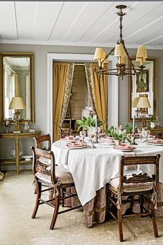 The Dining Room - Charming Mountain Cottage - Southernliving. The dining room walls are painted Stonington Gray by Benjamin Moore. Tieback curtains at the doorway provide separation from the adjacent kitchen.      Love it? Get it! Wall paint: Stonington Gray (HC-170)