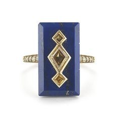 A beautiful cocktail ring featuring a rectangular lapis of 9.12 carats and canary diamonds set in 18k yellow gold. Rich lapis is accented by a kite-shape canar…