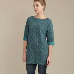 Fowey River Topaz.  A flattering tunic top in a unique Seasalt print. In soft, cosy cotton, with an elegant boat neck, three quarter sleeves and handy pockets. Looks great dressed up with leggings and boots or thrown on with jeans and a scarf.