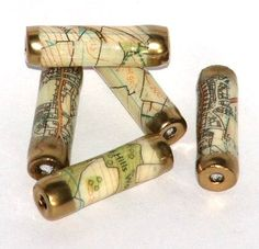 handmade paper beads made from recycled Ordnance Survey maps coated with ultra thick embossing enamel and tipped with gold embossing powder