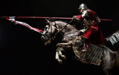 Charging Hussar. The much debated wings attached to the saddle rather than his back in this picture. (Probably more likely to my mind.)