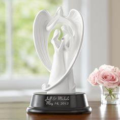 The heart,shaped wings of a guardian angel protect an embracing couple in  this elegant