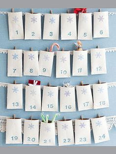 Christmas craft-All it takes to transform toilet paper rolls into something worthy of displaying in your home: acrylic craft paint, thread, a snowflake-shaped hole punch and numeral stamps. Hung by mini-clothespins from lace on a fabric-covered corkboard, the pockets can hold treats (chocolate, tiny toys) for the kids to discover each day in December.    Materials: