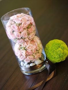 Centerpiece = 2 spray rose pomanders and one button pom pomander.