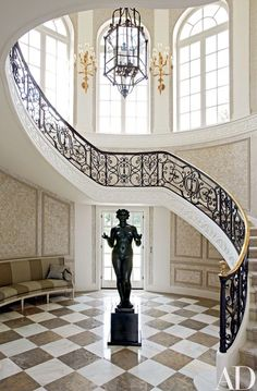 A 1930 bronze sculpture by Aristide Maillol centers the main stair, which Marino preserved | archdigest.com