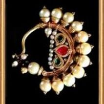 Lovely traditional gold, pearl and simply cut precious stones, nose ring craft jewelery from India