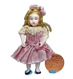 """Lynn McEntire - 2.5"""" high Antique Reproduction Porcelain Doll; sold on ebay for $69"""