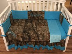 Items similar to 4 pc CAMO CRIB SET made with realtree fabric and turquois blue minky dot customized with your baby's name blanket, skirt, sheet, bumper pads on Etsy