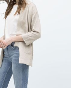 This is called a jacket on the site, but I'm sure it's a cardigan.  You know it's a staple - but it's not cotton.  Machine wash, but I probably wouldn't throw it into the dryer.  Zara - $29.90
