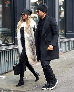 All black: All Of Me crooner John, 36, matched his wife with his own black beanie and dark...